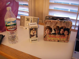 Dashboard Jesus and Goonies Lunch Box